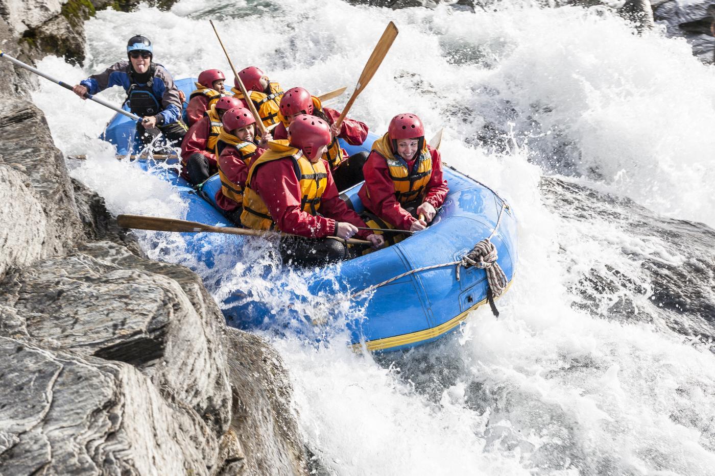 Rafting boat through white water rapids
