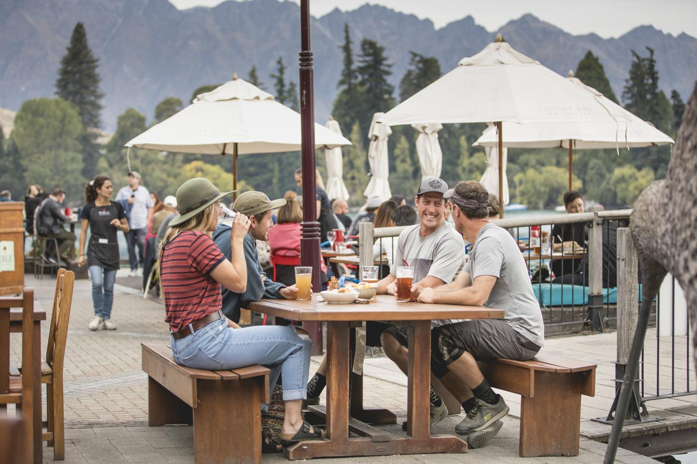 Group of friends enjoying Mountain Biking Apres outside at Atlas Bar