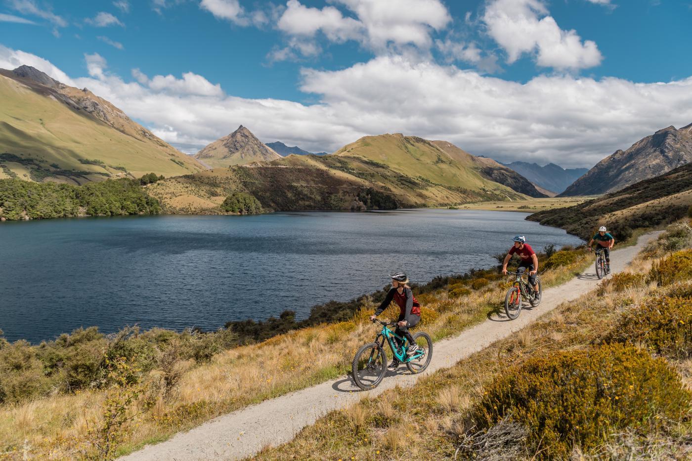 Friends mountain biking around Moke Lake