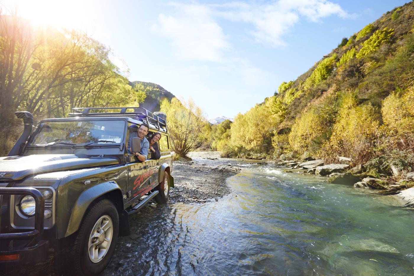 Nomad Safaris truck crossing river in Autumn