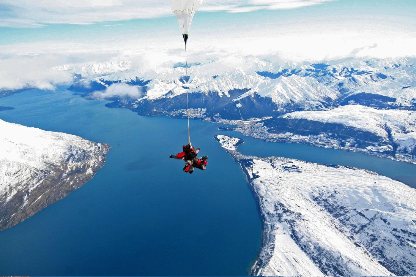 Winter Skydiving over snow-covered Queenstown