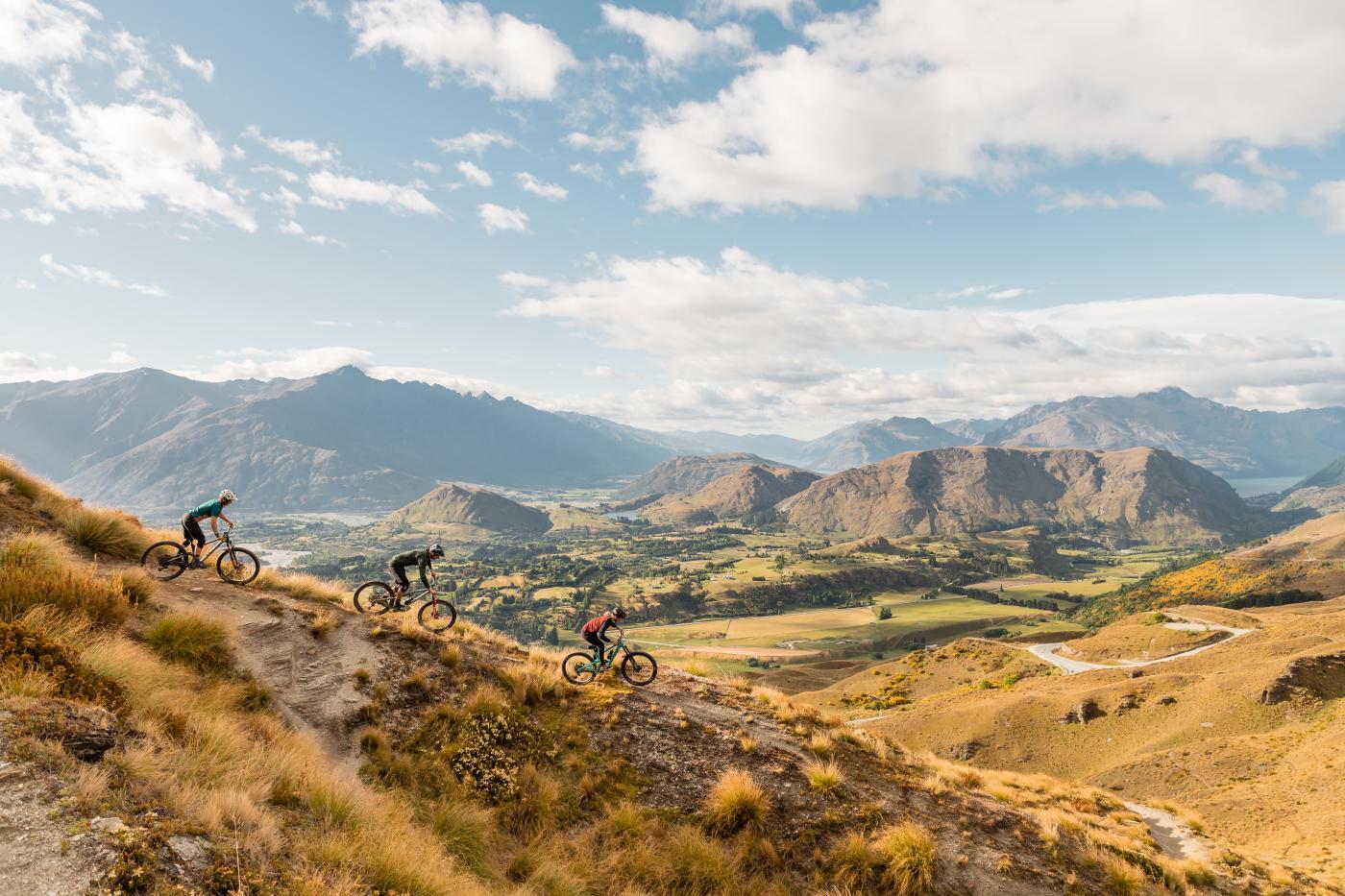 Three mountain bikers on Pack Sack and Track Trail, Coronet Peak