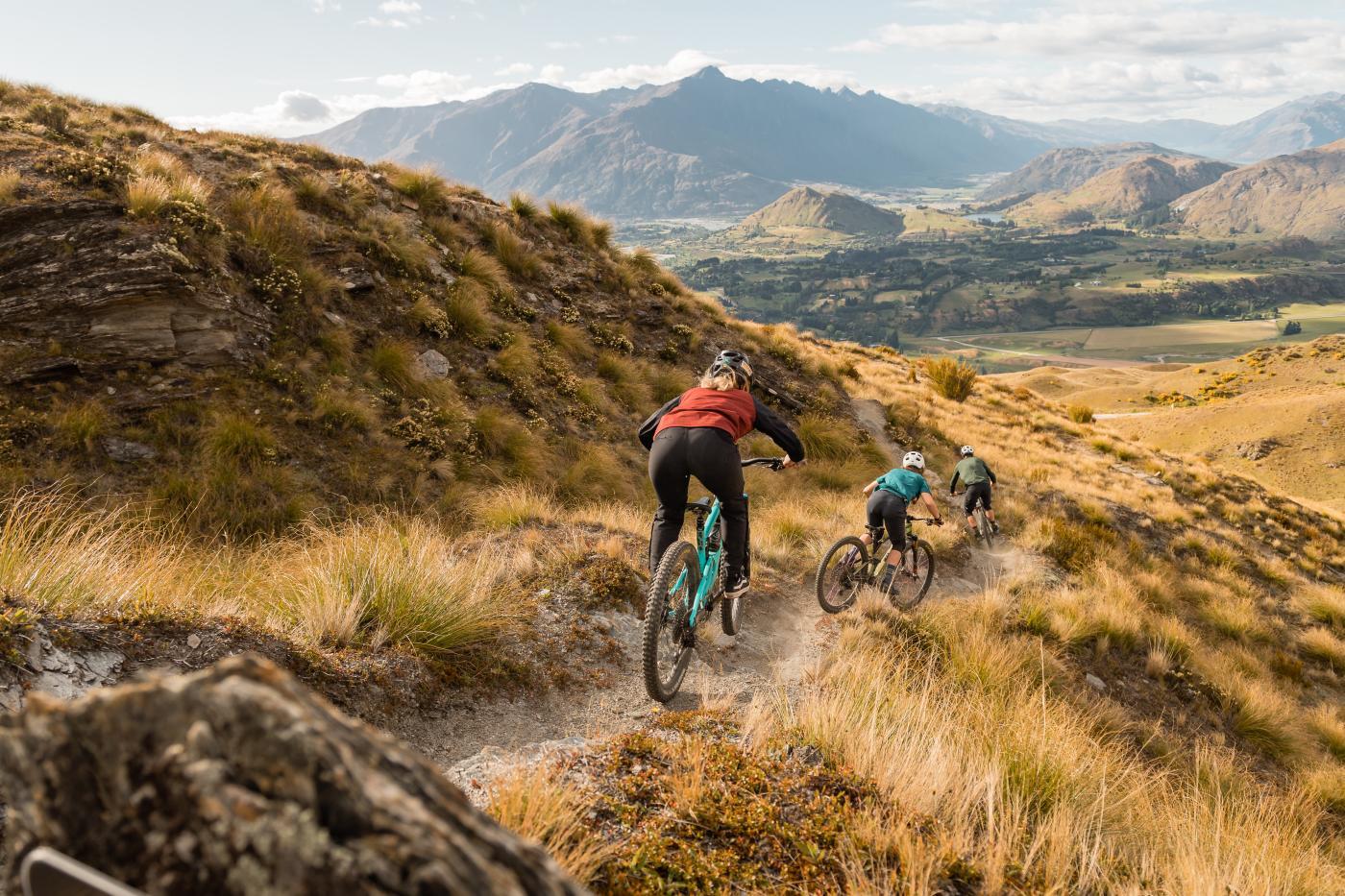 Mountain bikers downhill on Pack Sack & Track, Mountain Bike Trail, Coronet Peak