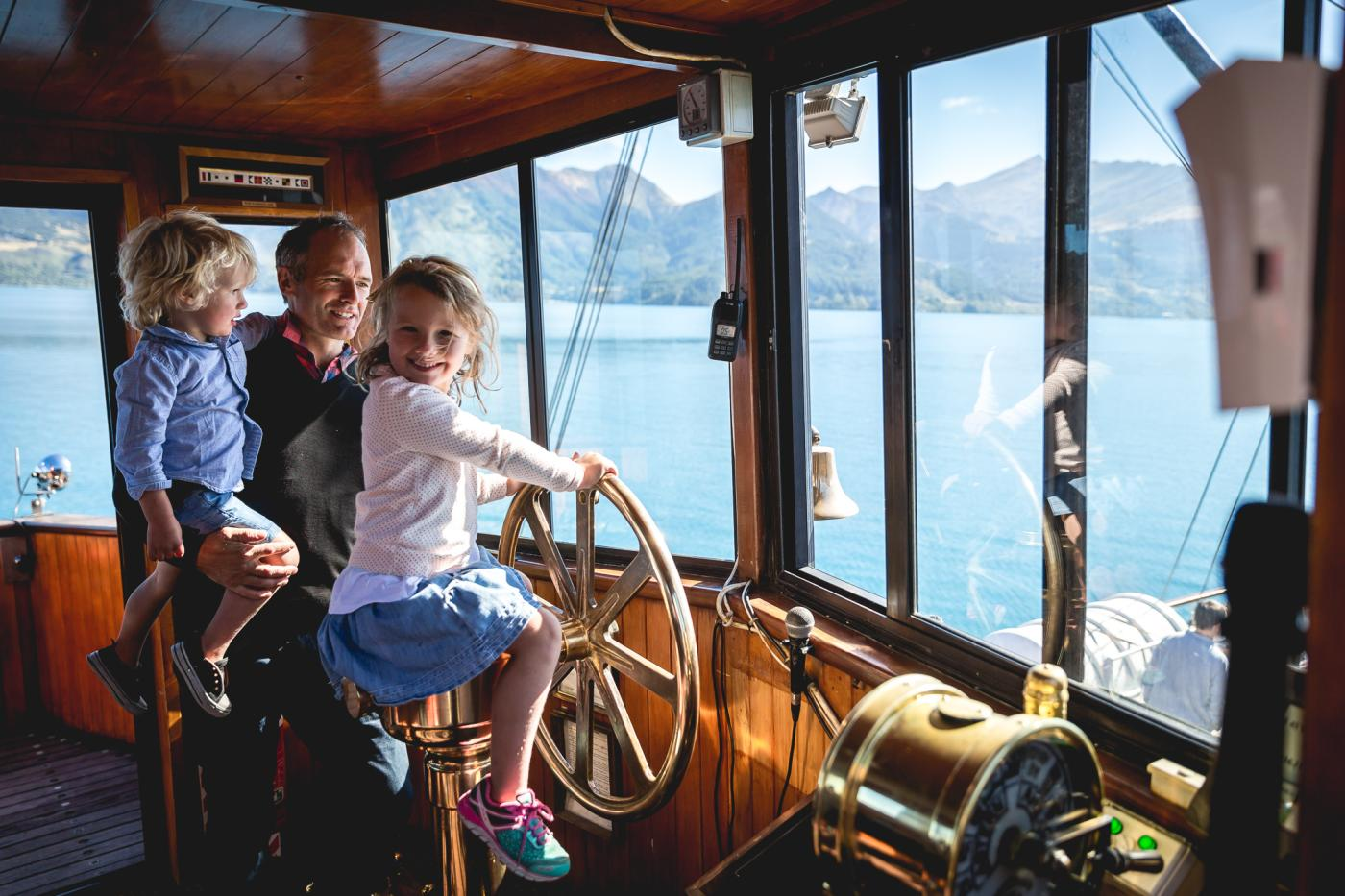 Young girl steering the TSS Earnslaw Steamship