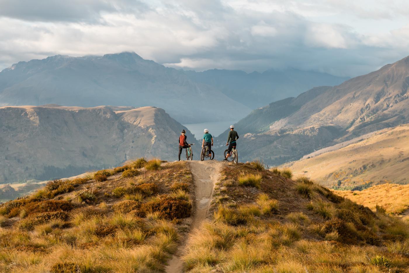 Riders overlooking Queenstown at Rude Rock, Coronet Peak