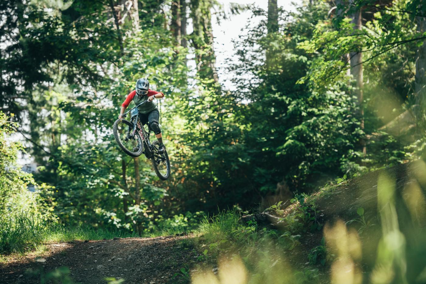 Female MTB rider jumps at Queenstown Bike Park