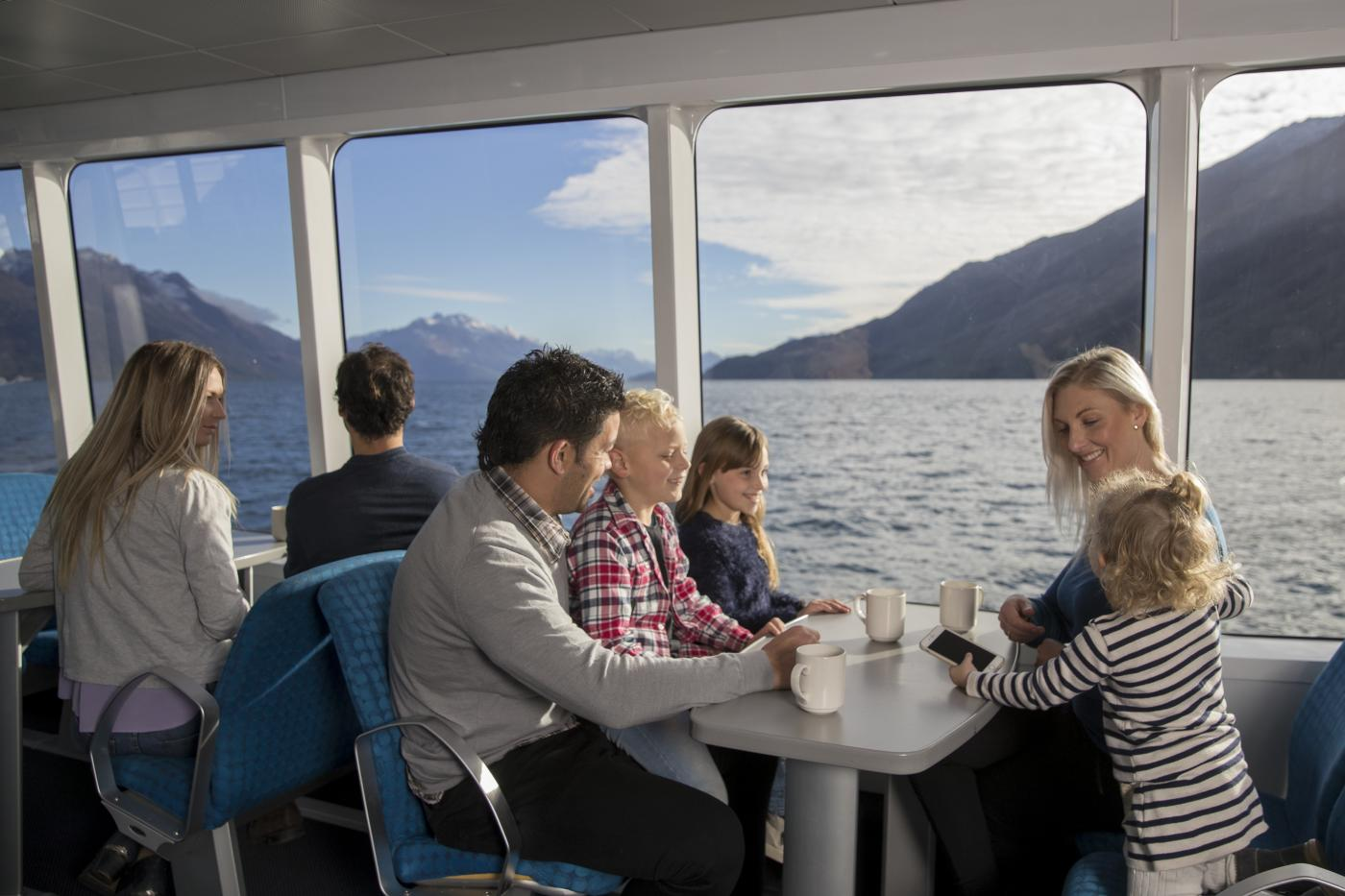 Family seated on the Spirit of Queenstown Scenic Cruise