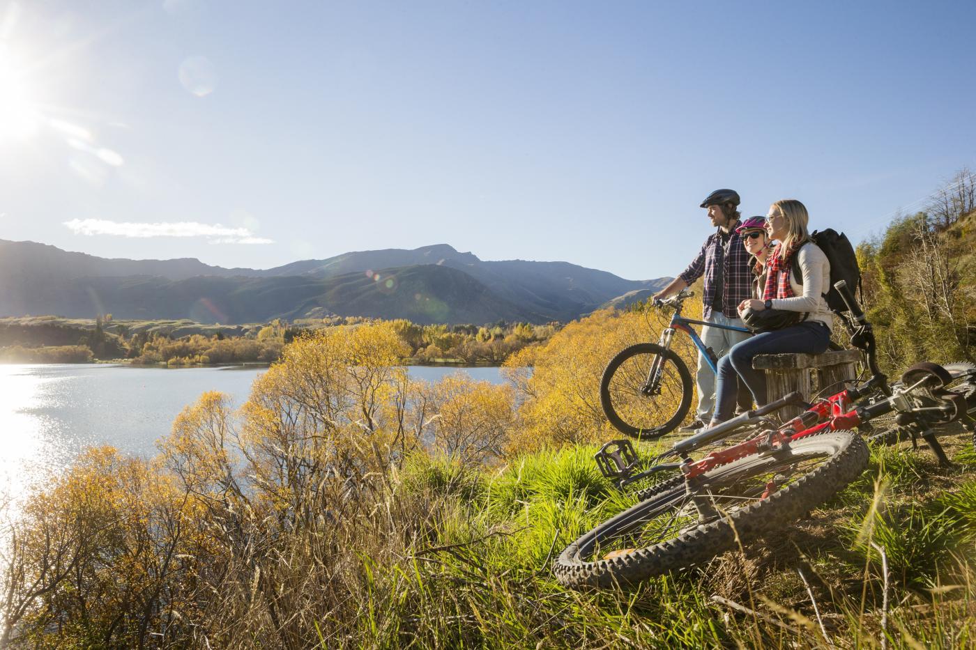 Friends Biking around Lake Hayes in Autumn