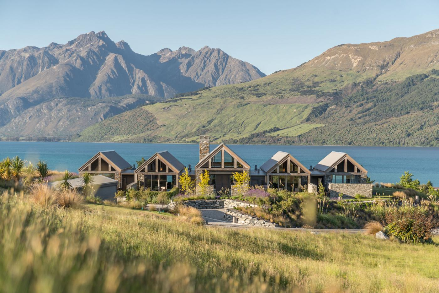 Blanket Bay Villas with mountain and lake backdrop
