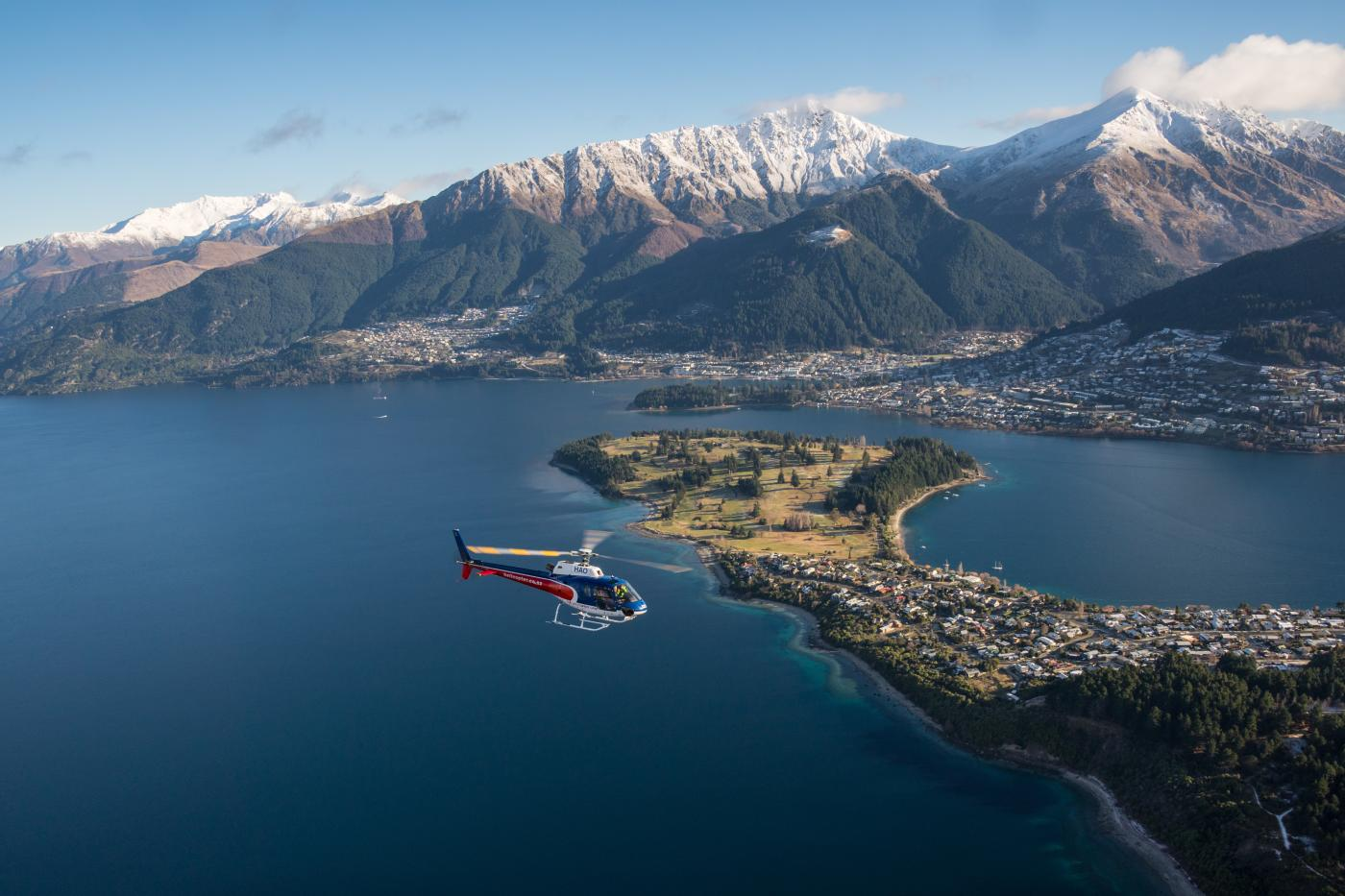 Helicopter flying over Queenstown Lake