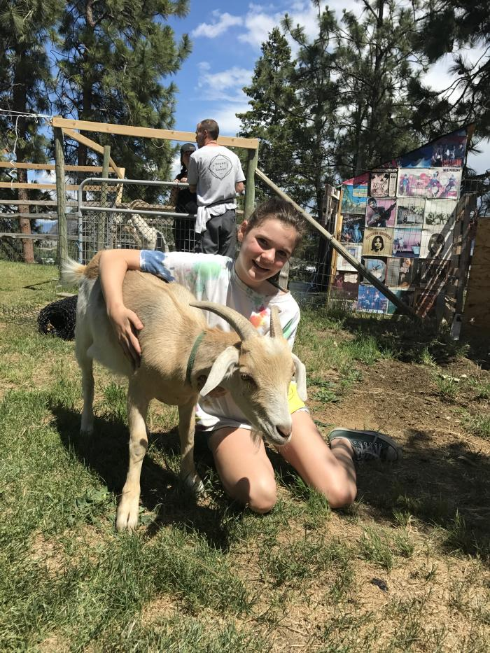 Petting a resident goat at Off The Grid Organic Winery