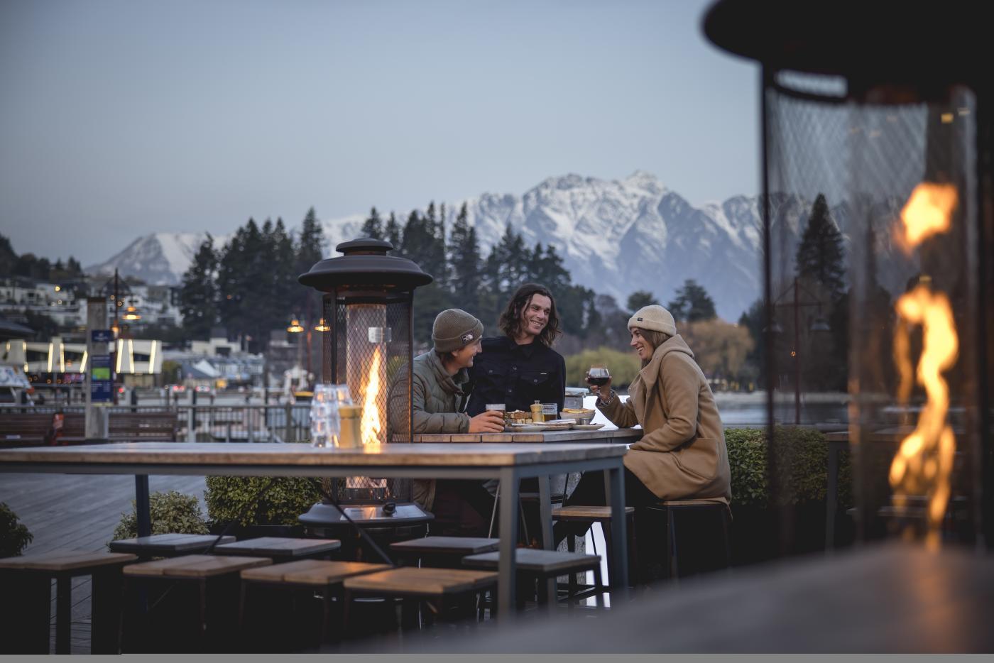 Friends dining outside in Winter