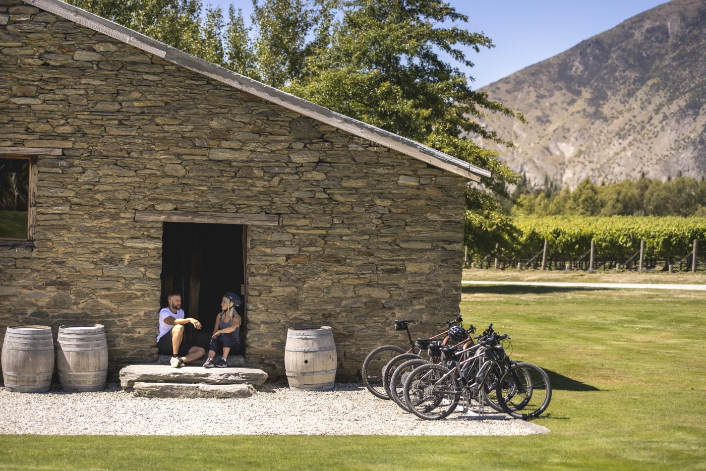 Couple with bikes at Peregrine Winery