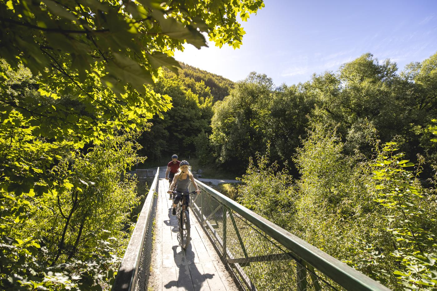 Cyclists biking in Arrowtown during summer