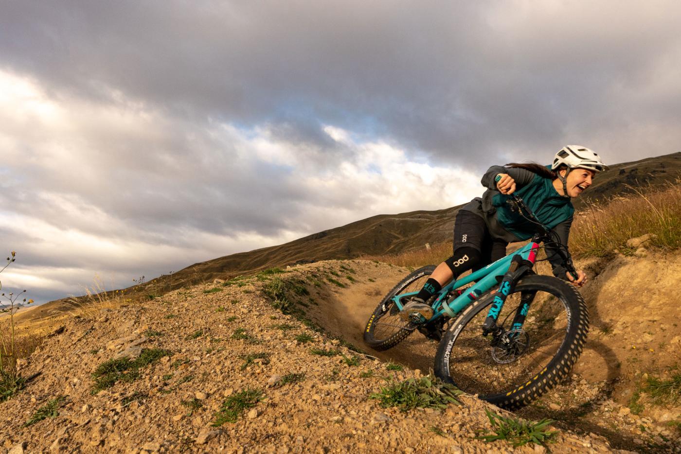 Woman Mountain biking at Cardrona