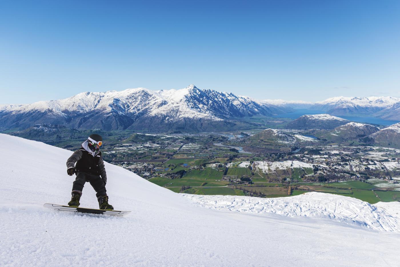 Coronet Peak Snowboarder on a bluebird day