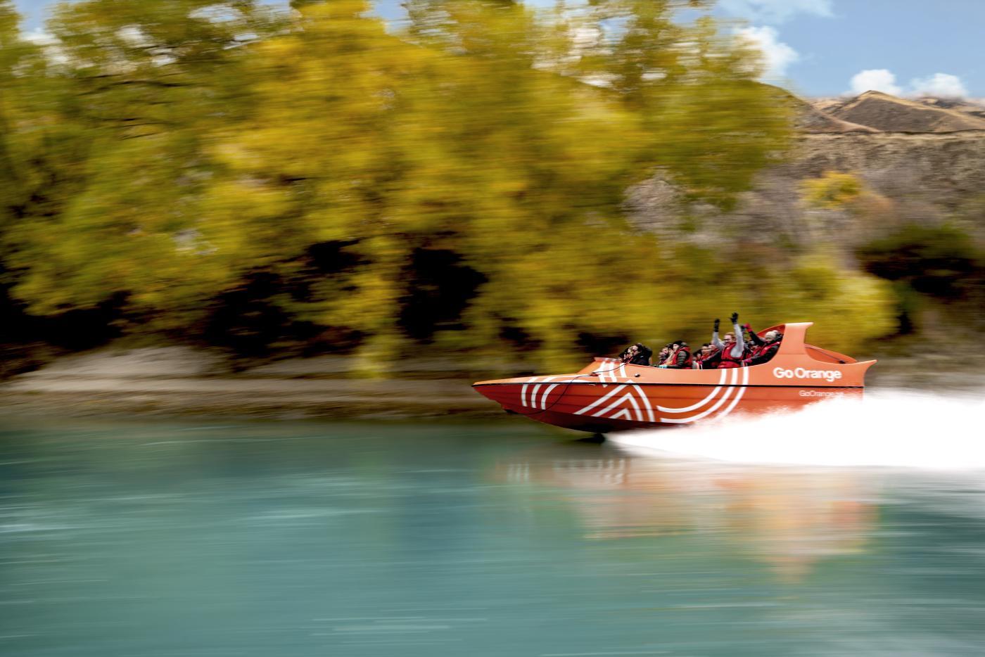 Go Orange Jet Boat speeding down the river