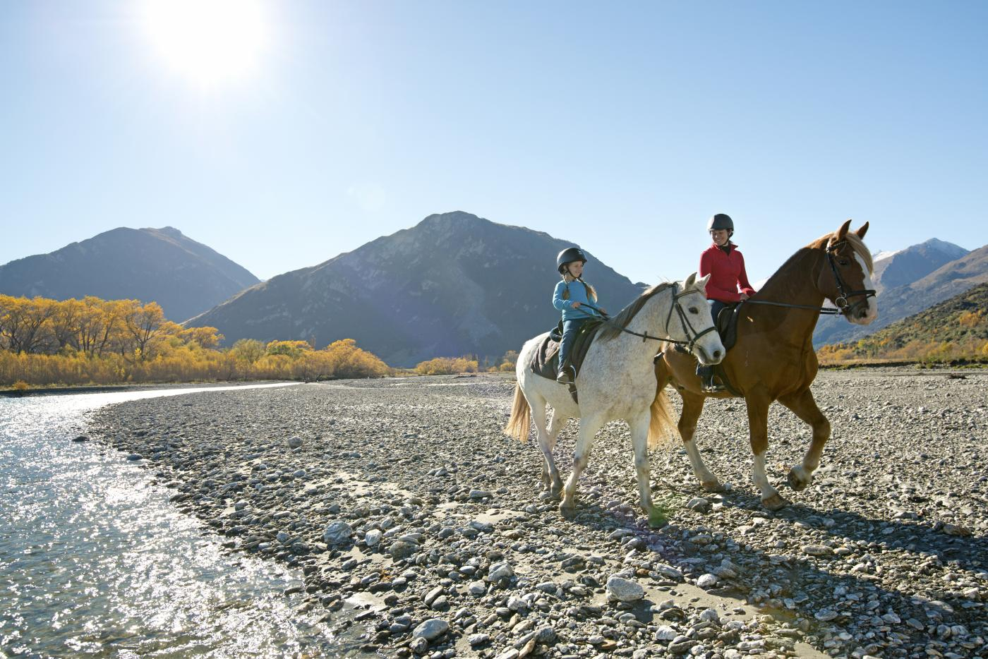 Young girl and mum riding horses in Glenorchy