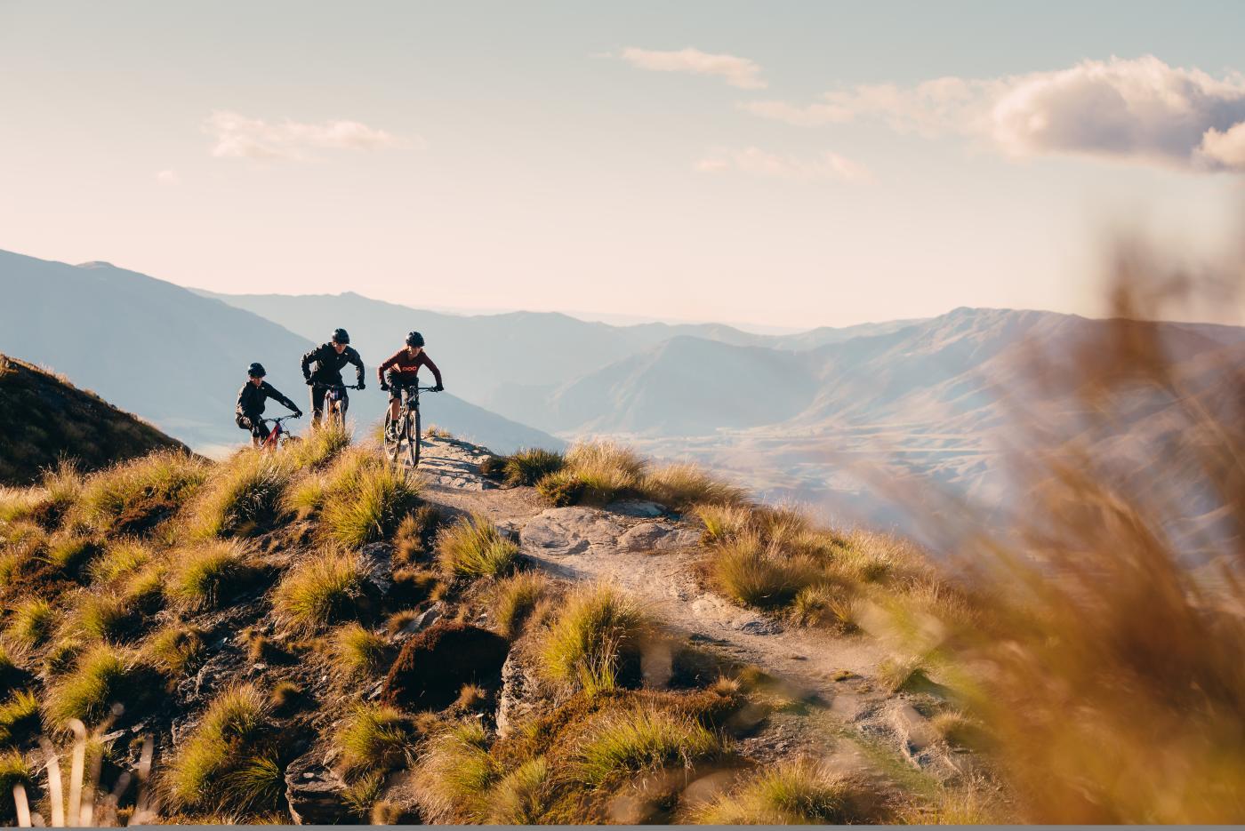 Friends biking Coronet Peak Mountain trails