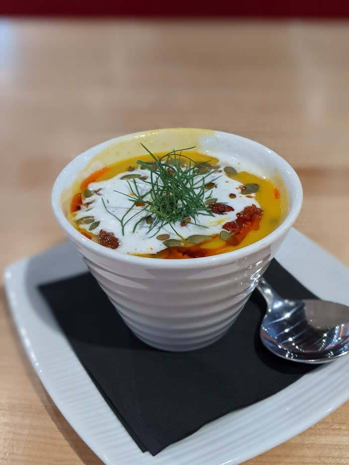 A white bowl filled with butternut squash soup with fennel sour cream on top at Butler's Pantry Cafe in Covington, Ky.
