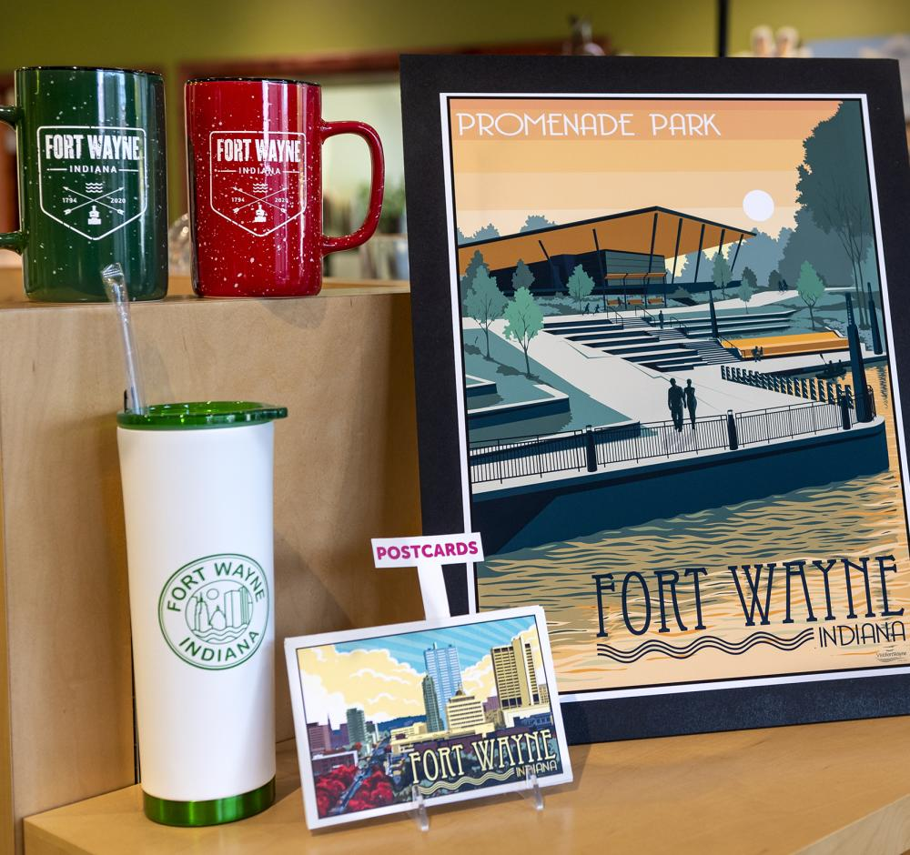 Fort Wayne camping mugs, water bottle, postcards, and poster at the Visitors Center