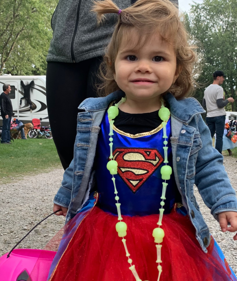 Little girl dressed up like Superwoman for Halloween