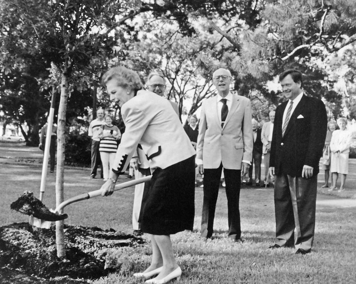 Prime Minister Margaret Thatcher plants a live oak tree at Sea Island, GA