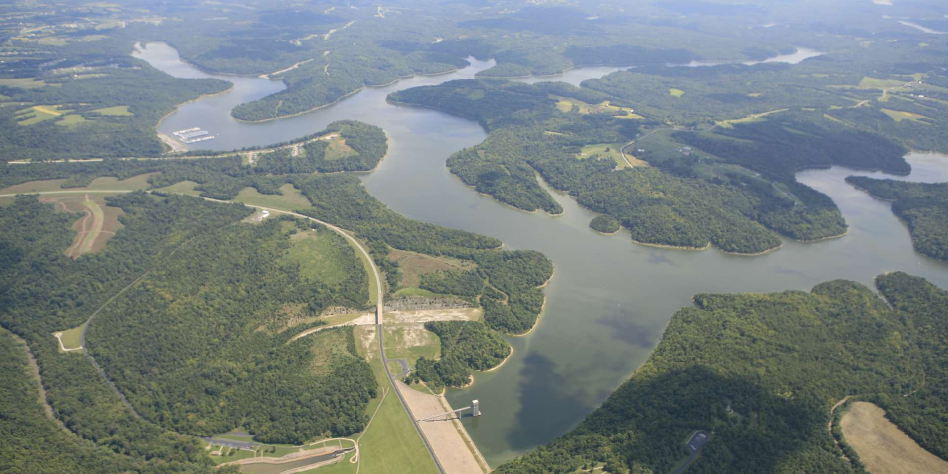 Aerial view with water and green landscape of Taylorsville Lake