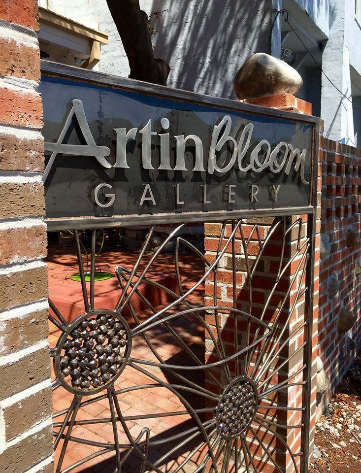 The metal gate at Art In Bloom Gallery was created by sculptor Dumay Gorham, III.