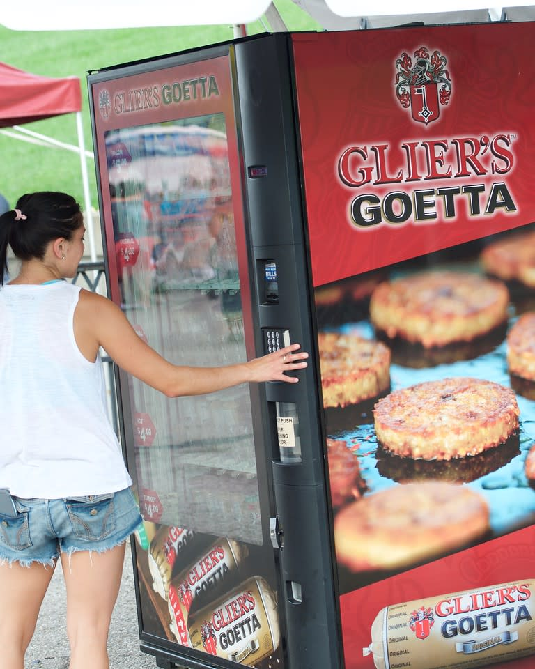 A woman placing an order at the Glier's Goetta Vending Machine