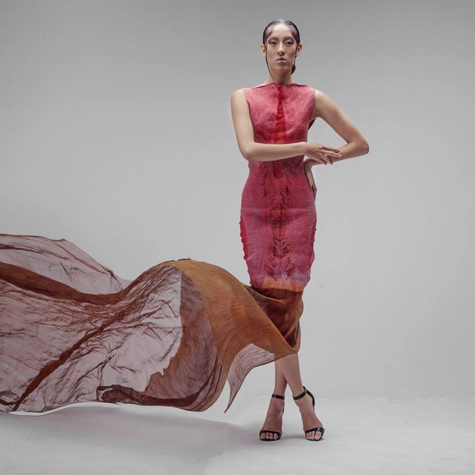 A Celeste Malvar-Stewart's design featuring bright colors and flowing fabric on a model.