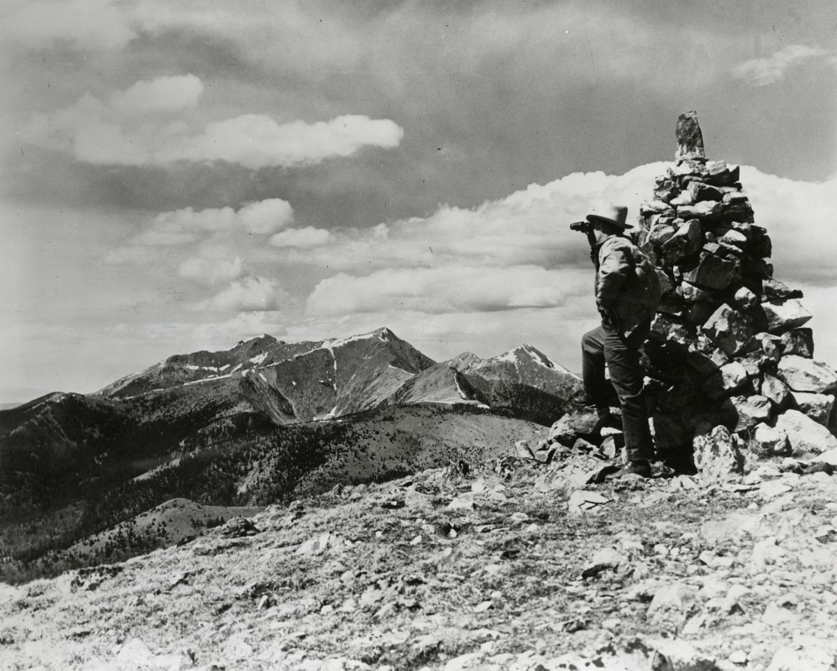 A 1940 New Mexico Magazine photo of a man looking at the Truchas Peaks from the Pecos Mountains