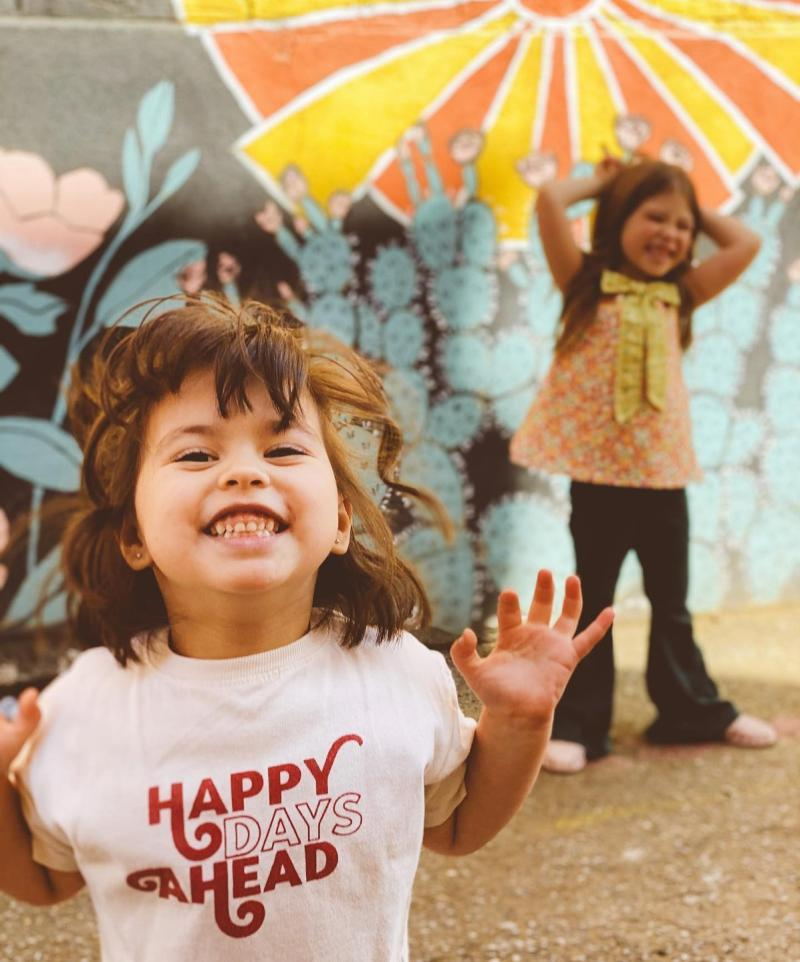 little girls with mural