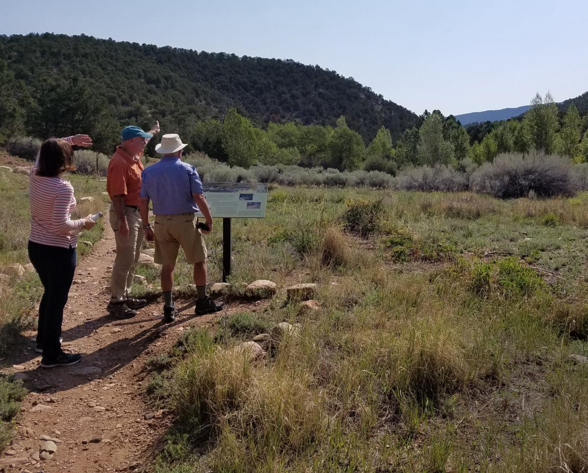 Terry Sullivan takes outdoor enthusiasts on a hike in the Santa Fe Canyon Preserve, New Mexico Magazine