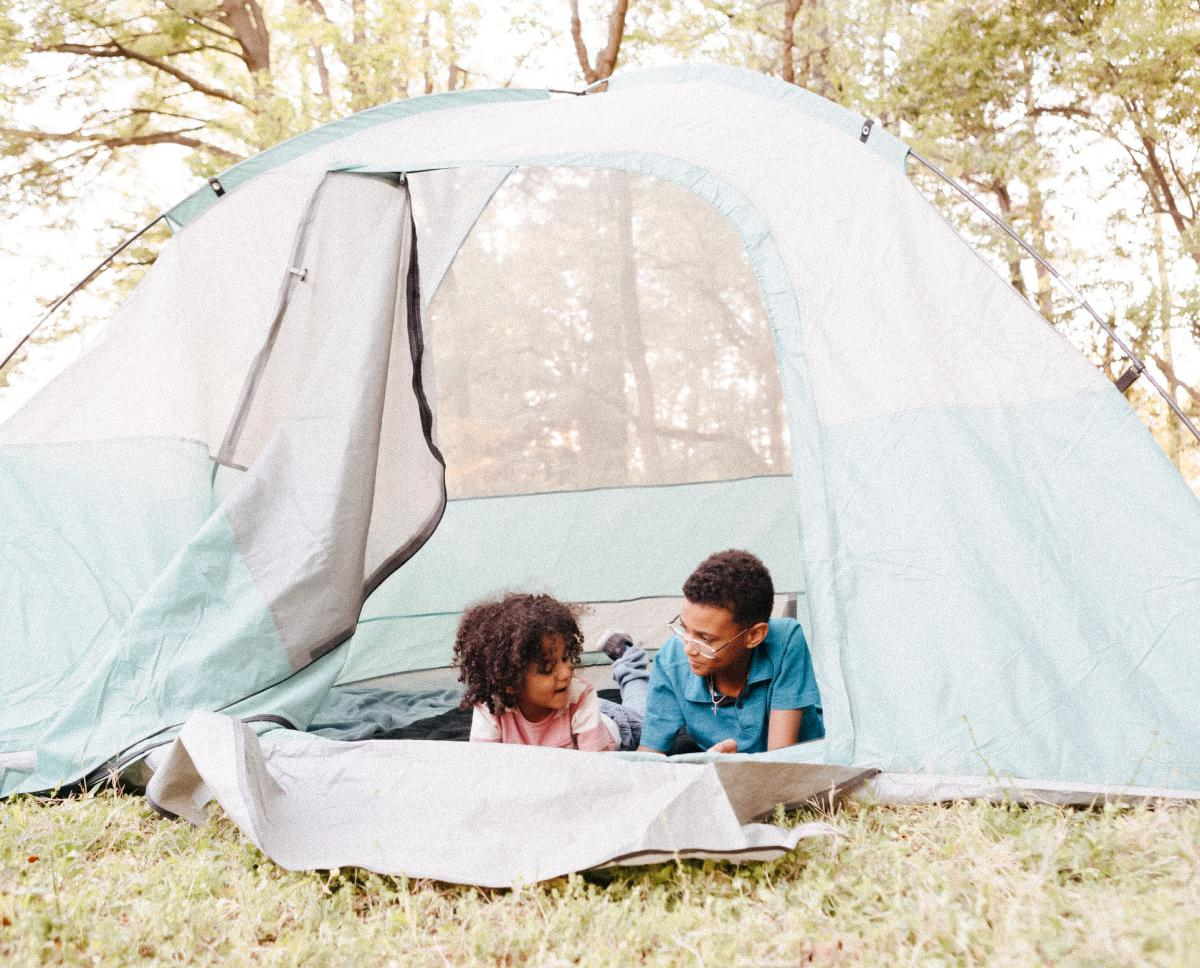 Two Children Camping In A Tent