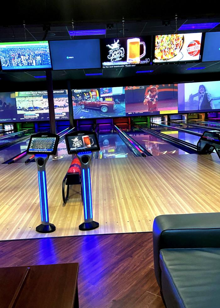 Bowling lanes and big screen TVs at the Fourth Dimension Fun Center in Frederick, MD