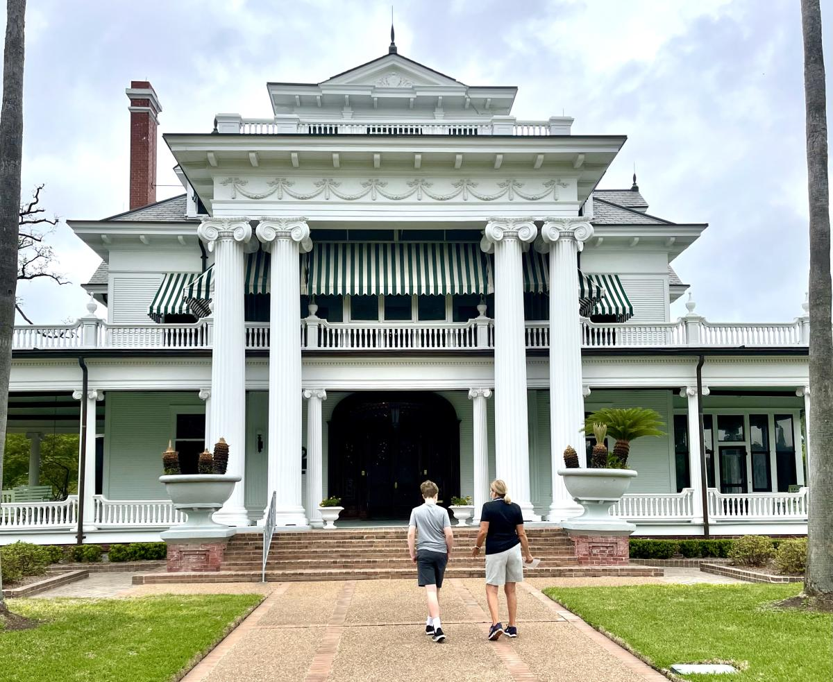 Two People Walking Up To The The McFaddin-Ward House In Beaumont, TX