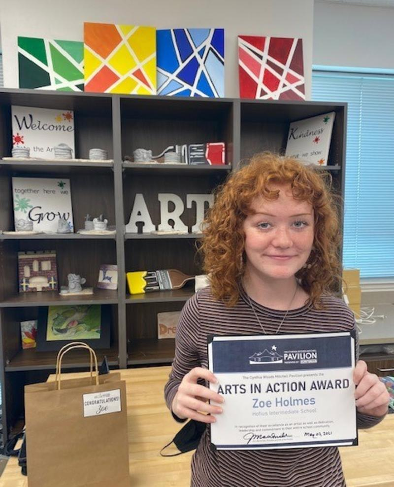 A performing arts student from Hofius Intermediate School poses with her Arts in Action Award certificate from The Pavilion.