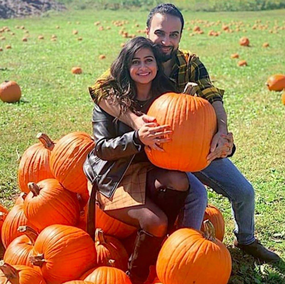 A couple posing with pumpkins at Terhune Orchards