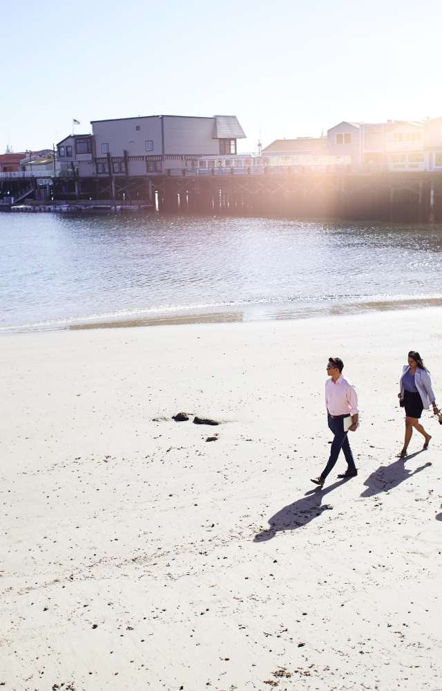 Walking on the beach near Monterey Wharf