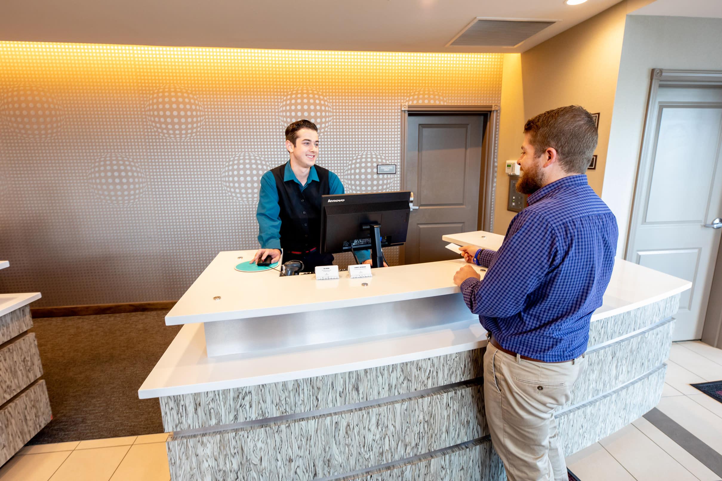 Man at Hotel Reception Desk