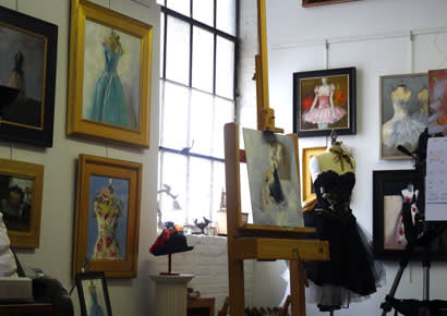 Art studio surrounded by paintings