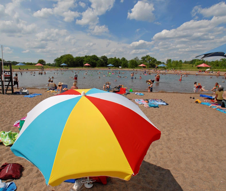Umbrella on beach next to water