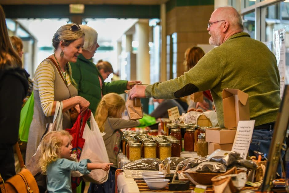 Customers buying goods at indoor farmer's market