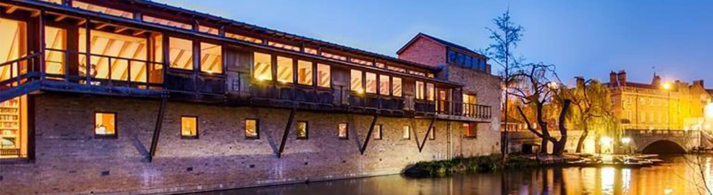 Darwin College on the banks of the River Cam as the sunsets.