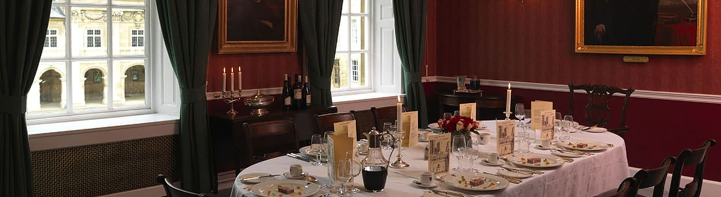 The Fellows' Breakfast Room set for a private dinner, a traditional room with windows overlooking Front Court.