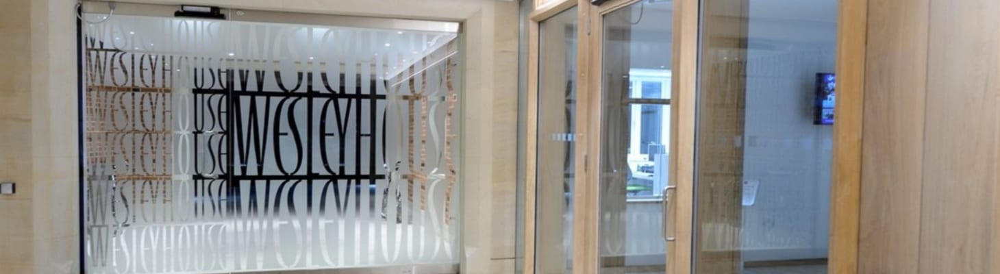 The modern and bright entrance foyer at Wesley House, Cambridge.