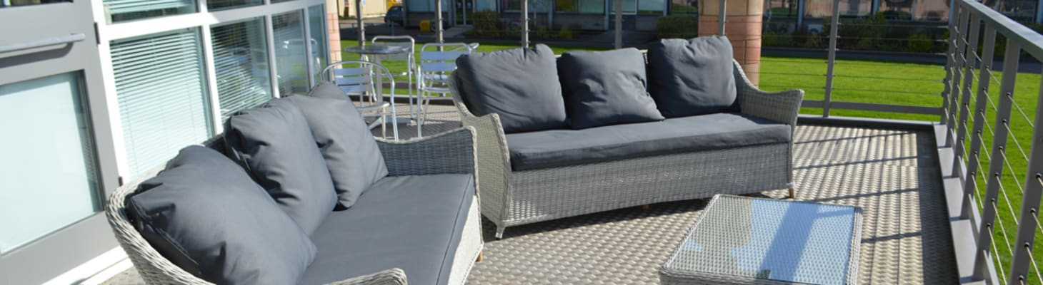 Balcony space with comfortable chairs, suitable for a summer drinks reception.