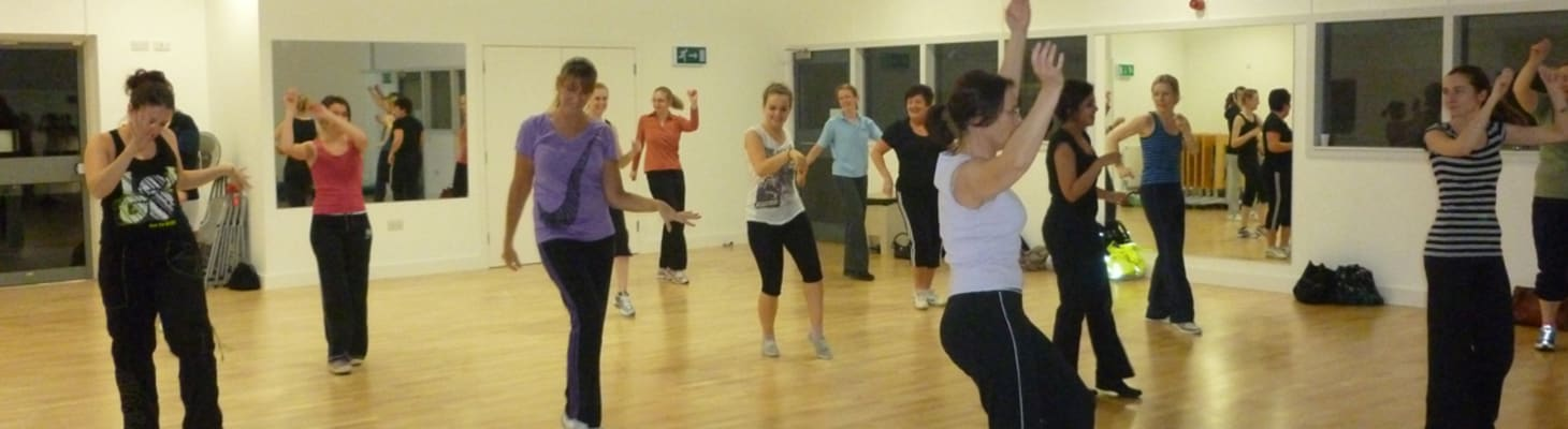 The dance and fitness studio with fitness class participants.