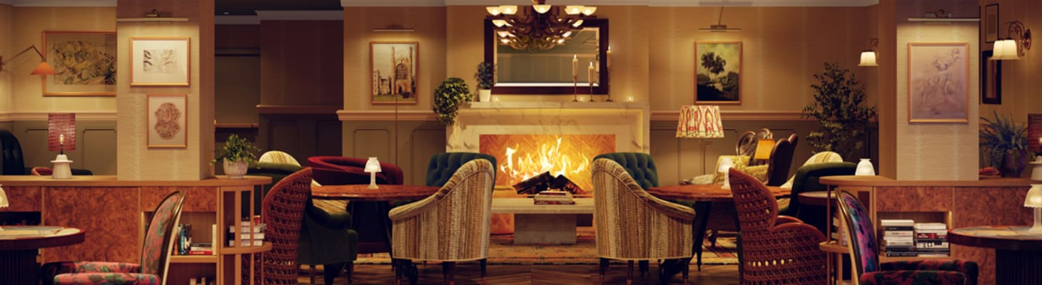 Chairs and tables set around a large impressive warm toned lounge area with a central fireplace making a perfect event venue